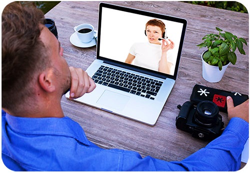 Man Attending Video Conference Through Laptop Computer