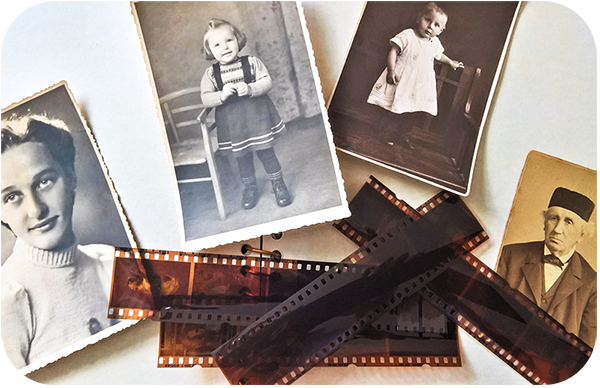 Collection of Old Photos Next to Film Roll